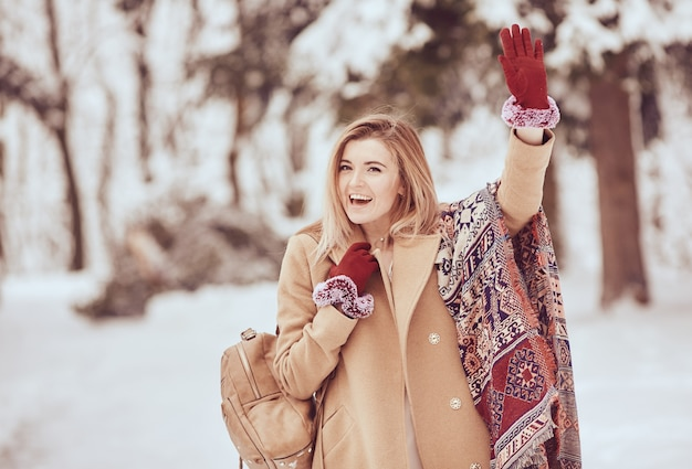 Smiling beautiful girl in a stylish winter outlook Free Photo