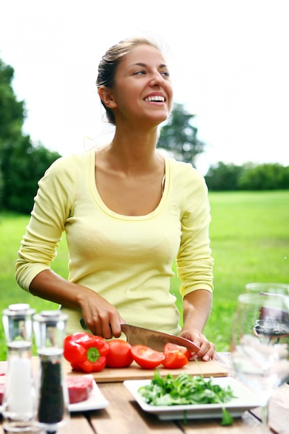 Smiling and beautiful woman cooking Free Photo
