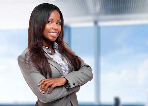 Smiling black businesswoman in her office Premium Photo