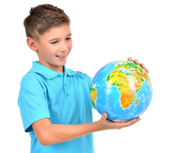 Smiling boy in casual holding globe in hands isolated on white Free Photo