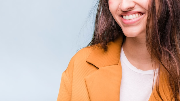 Smiling brunette girl posing with coat Free Photo