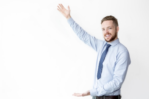 Smiling business man showing copyspace Free Photo