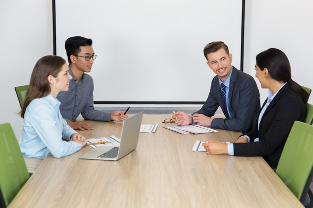 smiling business people at meeting in boardroom photo free download