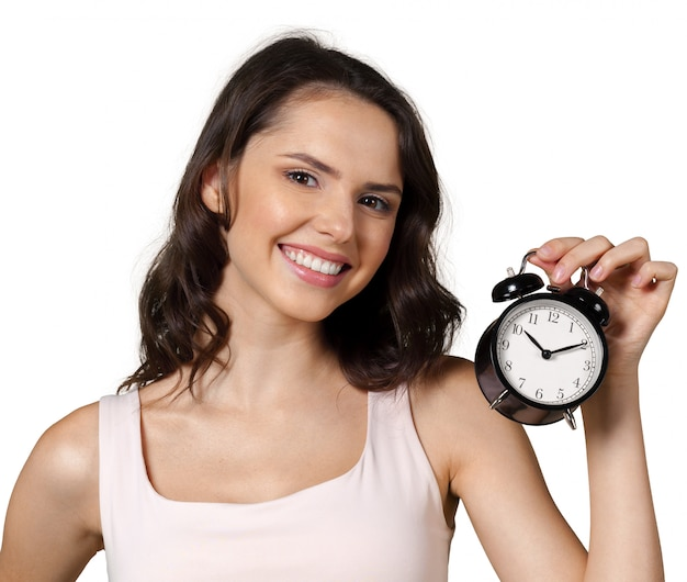 Smiling business woman holding alarm watch Premium Photo