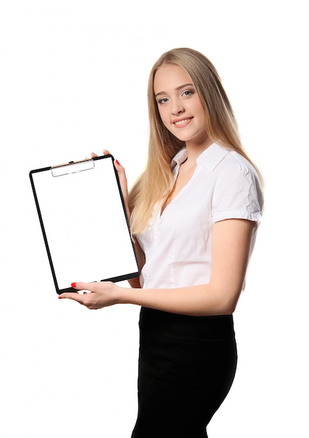 Smiling business woman holding document on clipboard isolated on white Premium Photo