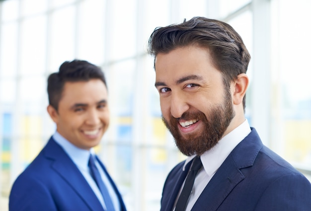 Smiling businessmen in the office Free Photo