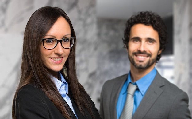 Smiling businesswoman congratulating with a colleague of her Premium Photo