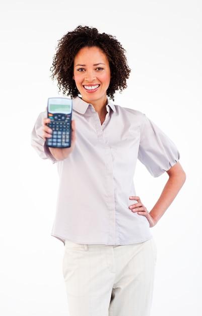 Smiling businesswoman holding a calculator Premium Photo
