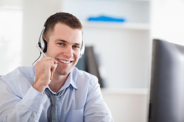 Smiling call center agent speaking with costumer Premium Photo