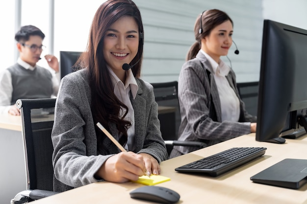 Smiling call center working Premium Photo