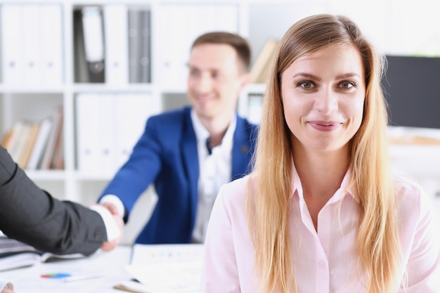 Smiling cheerful girl at workplace Premium Photo