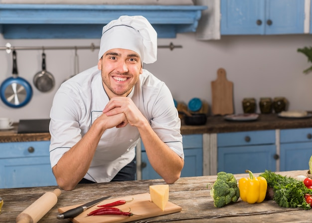 Smiling chef in kitchen Free Photo