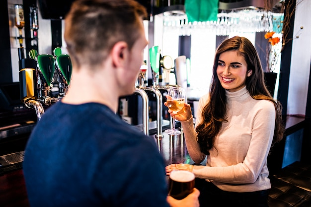 Smiling couple having a drink together in a bar Premium Photo
