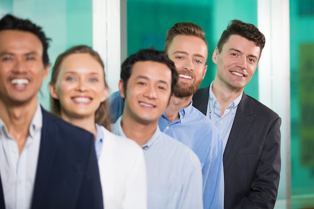 smiling diverse business people standing in row photo