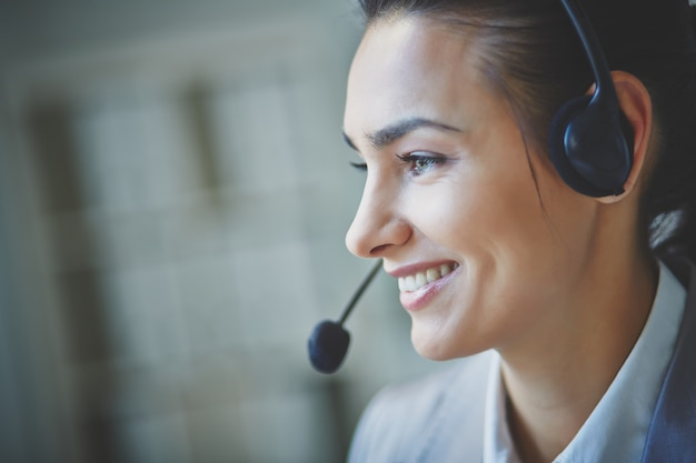 Smiling executive using headset Free Photo