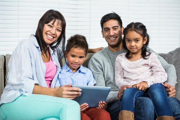 Smiling family using tablet Premium Photo
