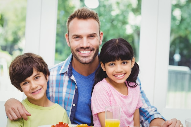 Smiling father and children Premium Photo