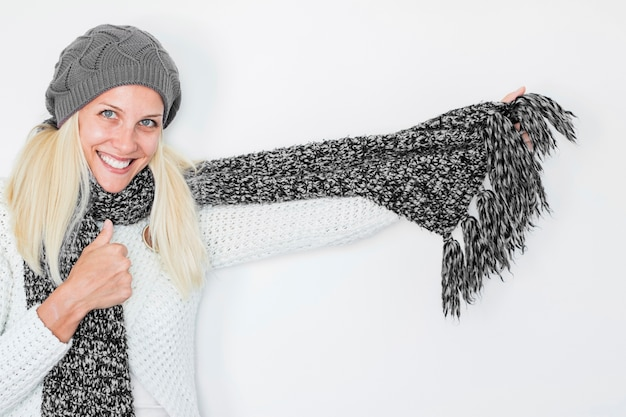 Smiling female in scarf and hat Free Photo