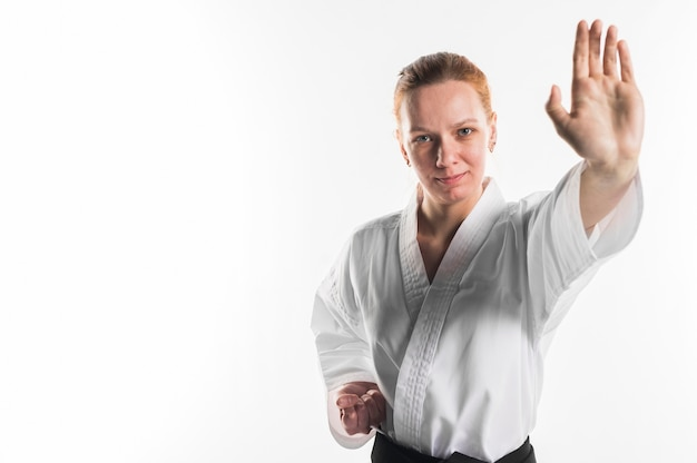 Smiling fighter doing karate pose Free Photo