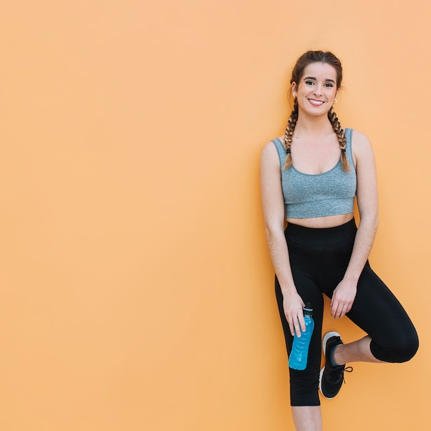 Smiling fit woman with blue drink Free Photo