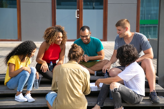 Smiling friends spending time outdoors Free Photo
