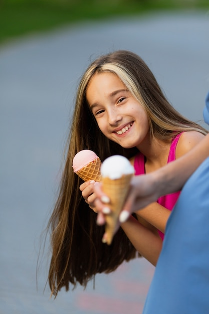 Smiling girl eating ice cream Free Photo