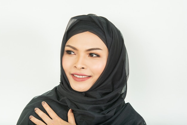 Smiling girl in hijab covering beautiful with happiness and color wall Premium Photo