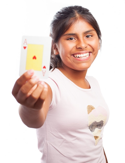 Smiling girl holding a poker card Free Photo