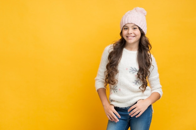 Smiling girl in sweater with snowflakes Free Photo
