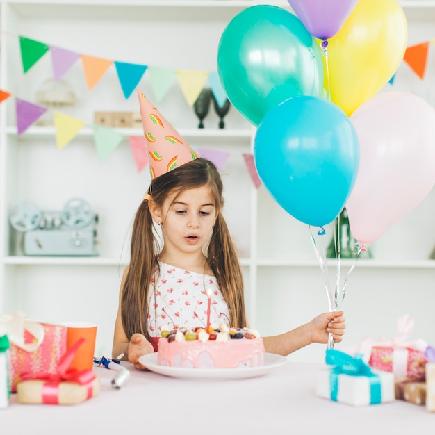 Smiling girl with a birthday cake Free Photo