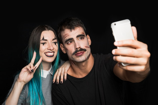 Smiling girl with man taking selfie on phone Free Photo