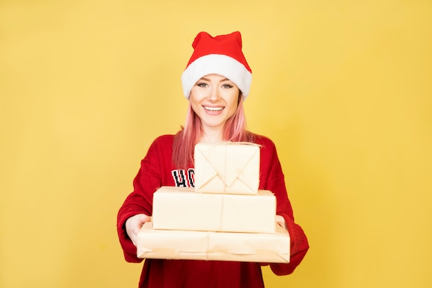 Smiling girl with red santa suit 2 Free Photo