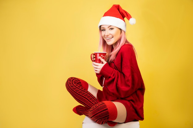 Smiling girl with red santa suit Free Photo
