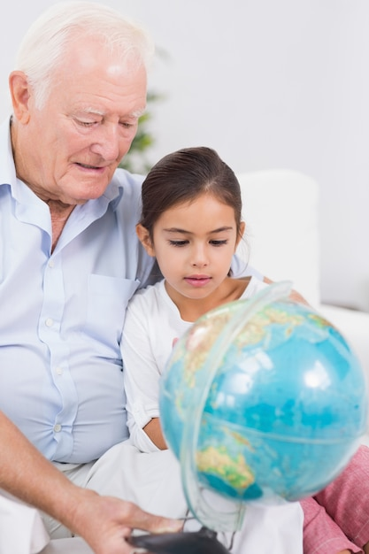 Smiling Granddaughter And Grandfather With Globe  Premium -3866