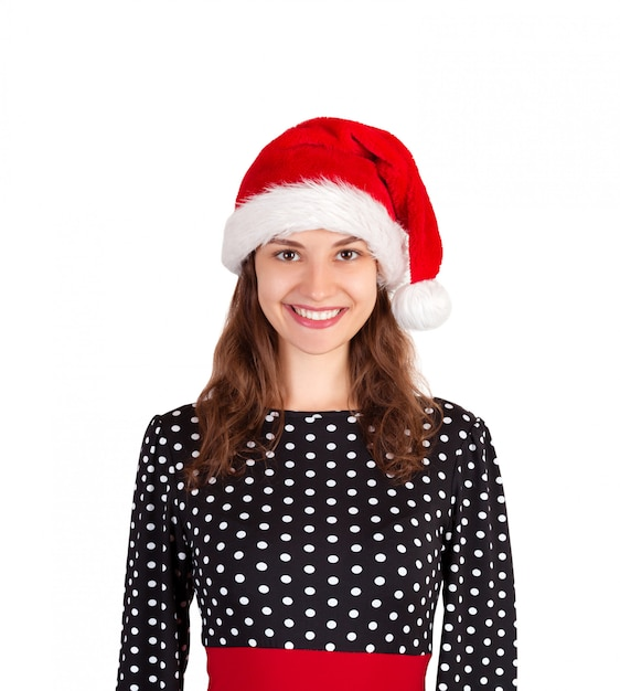 Smiling happy woman in dress. emotional girl in santa claus christmas hat isolated on white . holiday Premium Photo