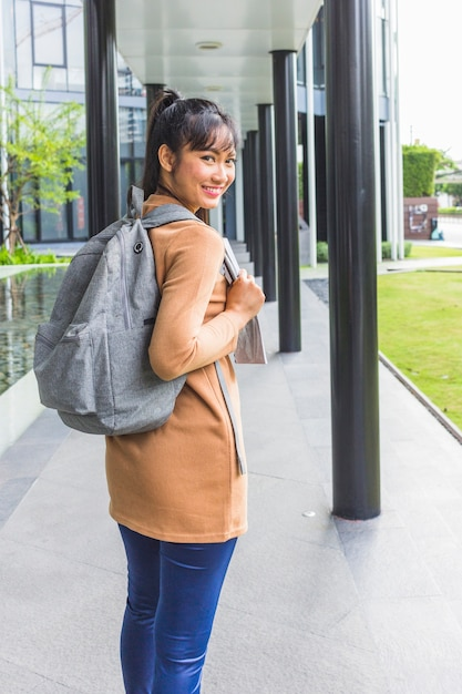 Smiling lady with backpack and documents Free Photo