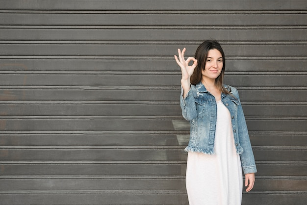 Smiling lady with ok gestures Free Photo