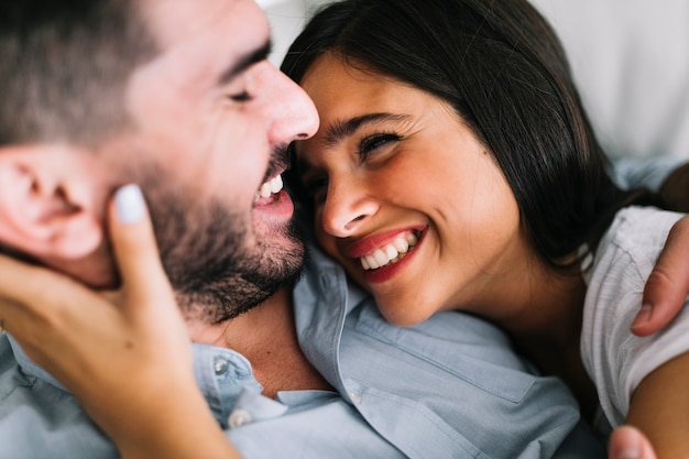 Smiling loving young couple looking at each other Free Photo
