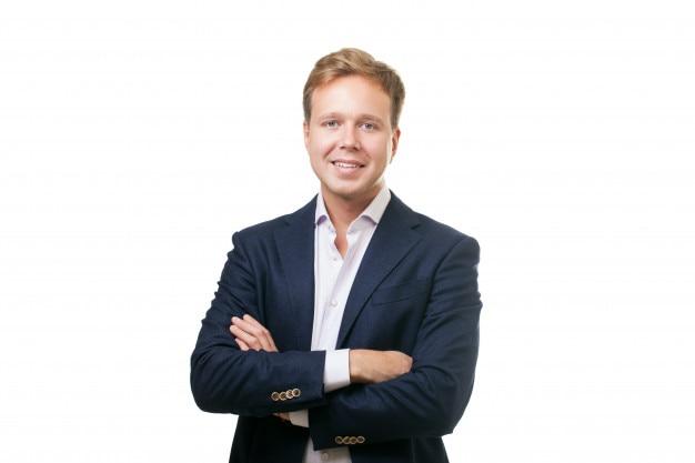Smiling man in black suit Premium Photo