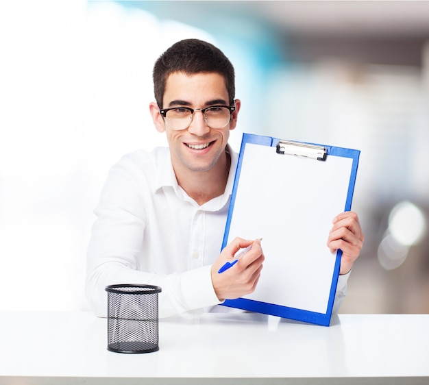 Smiling man with a check table Free Photo