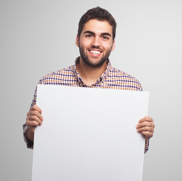 Smiling man with a paper sheet Free Photo