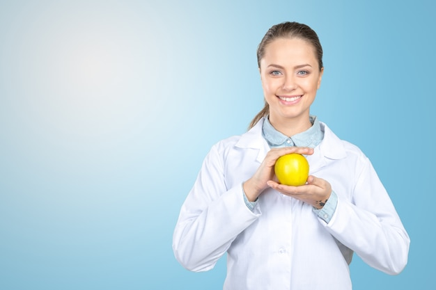Smiling medical doctor woman with apple Premium Photo
