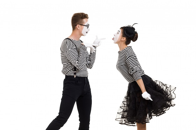 Smiling mimes in striped shirts. Premium Photo
