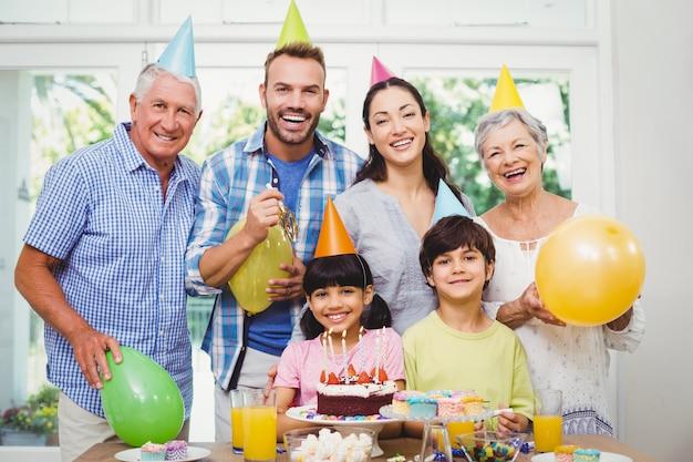 Smiling multi generation family celebrating a birthday party Premium Photo