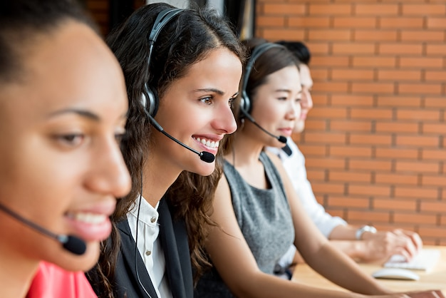 Smiling multiethnic telemarketing customer service agents, call center job concept Premium Photo