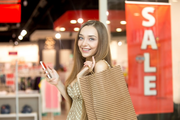Smiling oung girl with a brown bag Premium Photo