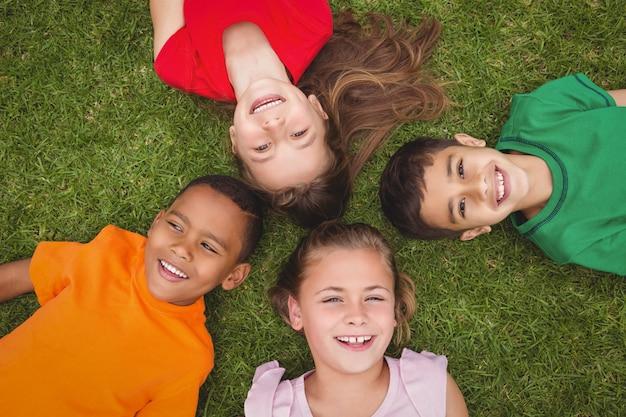 Smiling pupils lying on the ground Premium Photo
