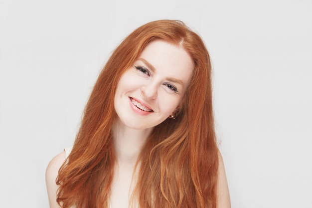 Smiling redhair girl wearing braces, cheerful portrait Premium Photo