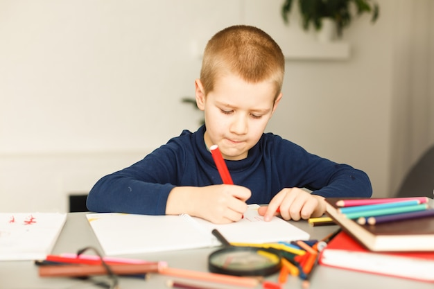 Smiling student boy with book at home Premium Photo