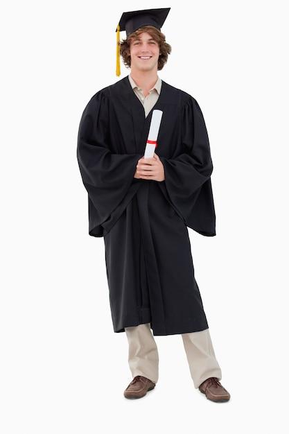 Smiling student in graduate robe Premium Photo